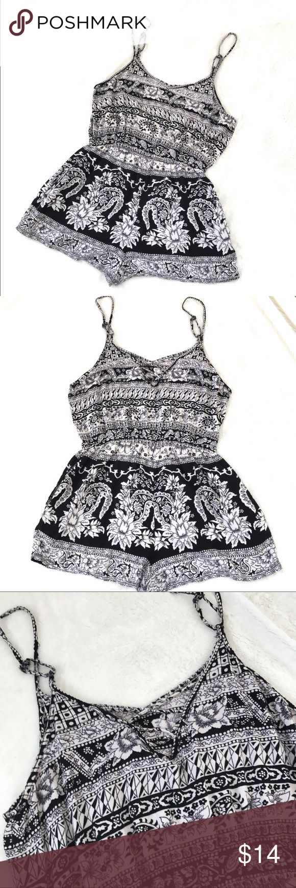 Black and white floral Romper festival Boho cute Super adorable black and white floral Romper. Elastic waistband and the straps are adjustable. Hard to see in photos but the back has cute little cross cross straps. Tag says Large so it must be juniors, I would say it would more accurately fit a small. Please see measurement photos and feel free to ask any other questions. In good preowned condition from smoke and pet free home. Dresses Mini