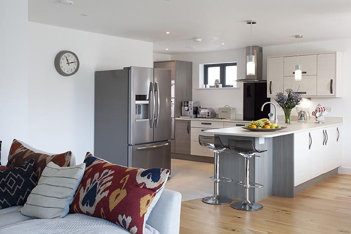 Open plan kitchen, dining and lounge area with sliding doors out into the garden