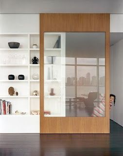 sliding door that doubles as a cabinet front on the built-in shelving, perfect for the library!