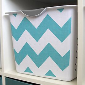 Spruce up your organization by covering plain white storage bins with your favorite fabric. Step-by-step instructions and template.