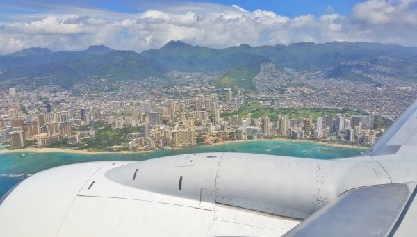 Flying past Waikiki and downtown Honolulu. With your Hawaii checklist, make airplane seats for flying to Hawaii essentials of things to do to see best beaches and hikes on your Hawaii flight, along with your Hawaii packing list when the Hawaii vacation is on Oahu. See the best snorkeling destinations in the USA from above! Make it a part of your bucket list to see Waikiki from the plane as you're flying into the Hawaii airport on Oahu after a long flight!