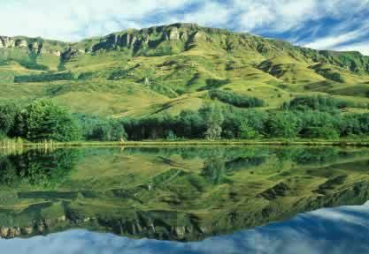 Explore Drakensberg. Drakensberg Travel Tips.  Where to Stay. The Mountains of the Dragon (Drakensberg) area, known as Ukhahlamba or Barrier of Spears to the Zulu people provides a wonderful natural semi circular border between KwaZulu-Natal and Lesotho.
