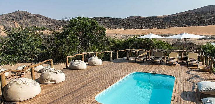 Serra Camp, Kunene, Namibia | Wilderness Safaris Cafema relax by the poolside and absorb the dramatic landscape
