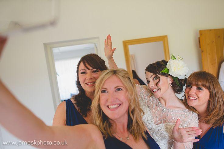 Bridal Preparation. Bride & blue bridesmaids. Hush Venues Norfolk Outdoor Wedding Venue. Wedding in the woods. Norfolk Wedding Photographer. www.jameskphoto.co.uk