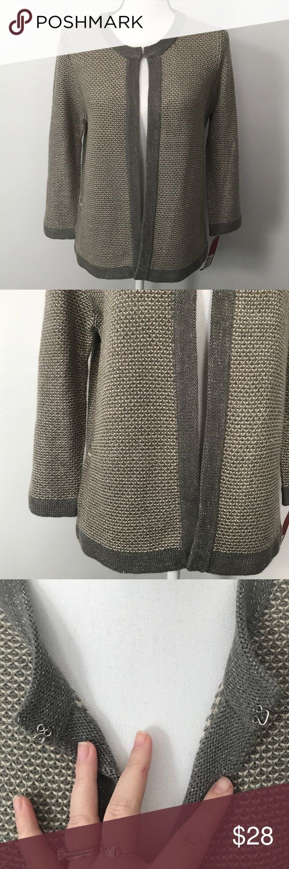 """NWT Merona Grey Silver Cardigan Sweater Jacket New with Tags Merona Grey Silver Cardigan 1 hook and loop button Closure at top Tag says """"sweater jacket grey"""" Size Medium 22"""" underarm to underarm measured flat  24"""" long Small pull on side - see pic Merona Sweaters Cardigans"""