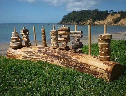 Log stacker. Tree cookies, wood blocks and scraps painted by kids.