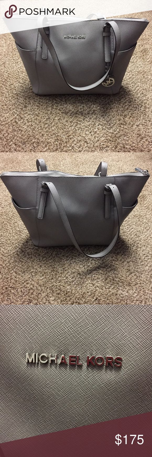 Michael Kors Jetset Medium Gray Tote Like new condition! Great sized bag along with a great color that goes with anything!!! Very clean inside and out with silver hardware. A must have for every wardrobe! Michael Kors Bags Totes