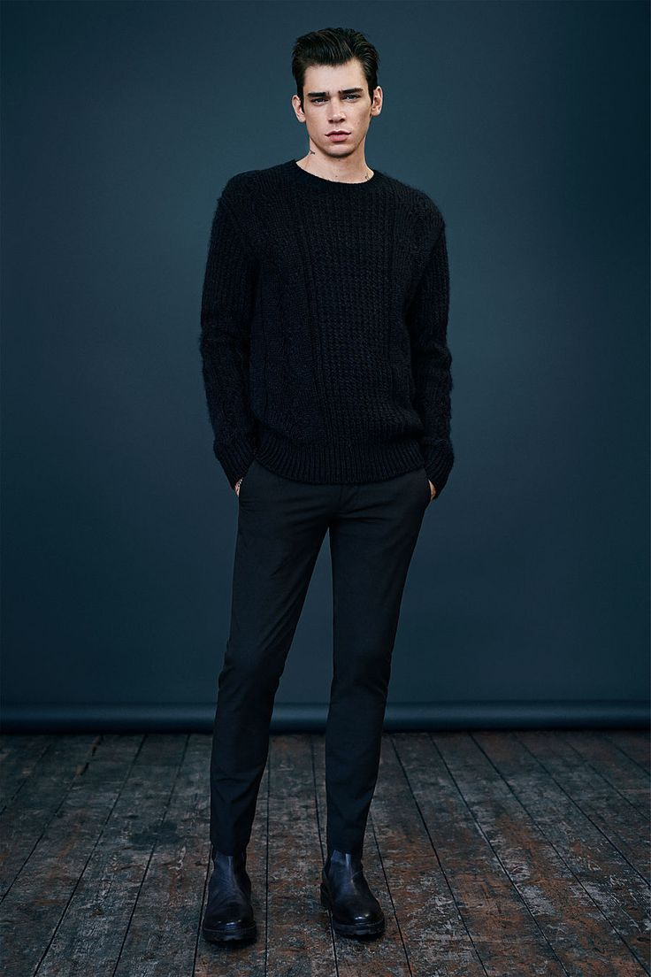 Shop this look on Lookastic:  http://lookastic.com/men/looks/black-cable-sweater-black-wool-dress-pants-black-leather-chelsea-boots/7878  — Black Cable Sweater  — Black Wool Dress Pants  — Black Leather Chelsea Boots