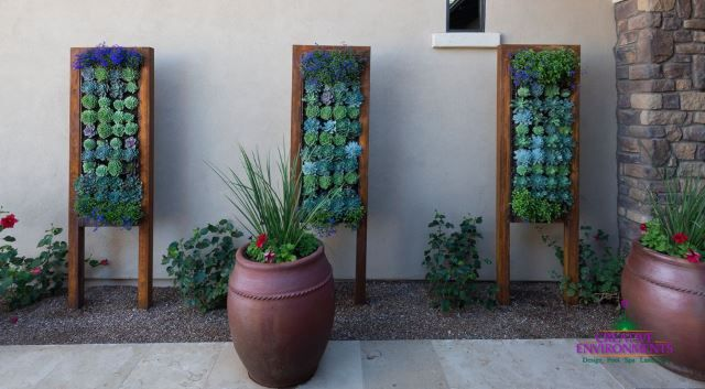 These garden concepts are so gorgeous to look at! Just look at all that vivid blue and green! This is a different way to incorporate vertical panels into the outdoor space. These almost double as a sort of garden artwork or fixture. Depending on your preference, you could use any type of color scheme you like.