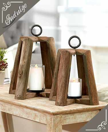 We love the ambiance that an Oversized Wood Lantern adds to any room. Made of solid wood and accented with a textured iron ring at the top, thecontemporar