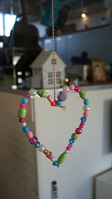 I love all these cute little shaped and colored beads. Would make a nice mobile for a girl's room!