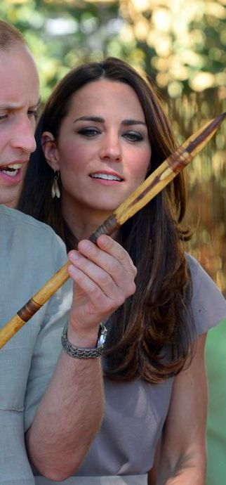 William and Kate are presented with an Aboriginal spear as they arrive at The National Training Academy in Ayers Rock Australia.