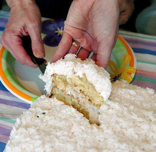 To make the yellow cake layers:  Preheat oven to 350 degrees. Prepare cake pans by lightly greasing with shortening, then dusting with flour. In a large...