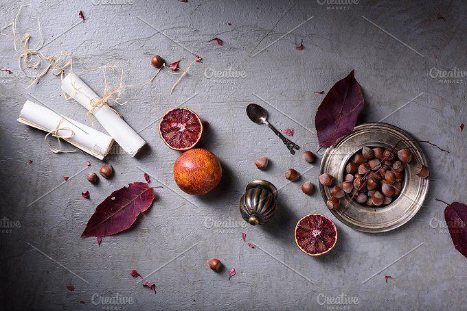Romantic love letters, nuts, oranges by Iuliia Leonova on @creativemarket