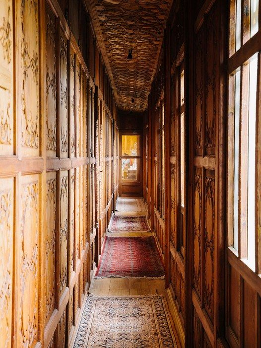 The hallway of Sukoon,  a luxury houseboat anchored in Dal Lake, Srinagar.