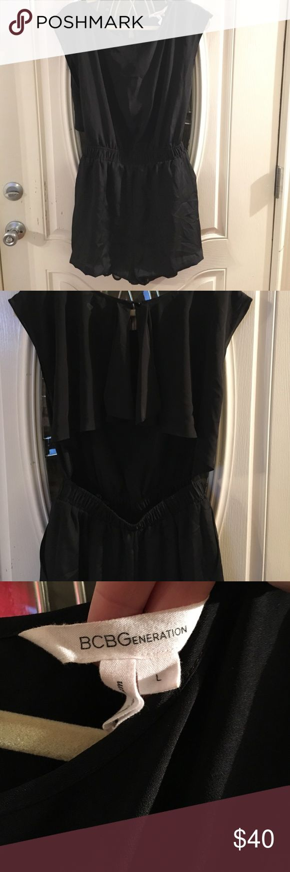 BCBGeneration Black Short Sleeve Romper Black short sleeved romper with an open back. Size large with pockets. Make me an offer! BCBGeneration Pants Jumpsuits & Rompers