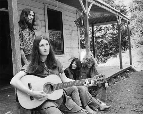 A group relax on the porch at poet James K. Baxter's commune at Jerusalem (Hiruhārama), up the Whanganui River,New Zealand in 1971. They were part of a counter-culture escaping the conventions of a suburban existence. In the 1970s many alternative lifestylers bought cheap land in places such as the Coromandel Peninsula and Golden Bay.