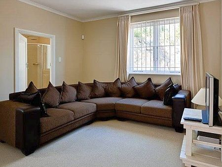 Self Catering Accommodation, Kalk Bay, Cape Town   Cuddle in front of a movie on this ever so extravagantly large sofa.