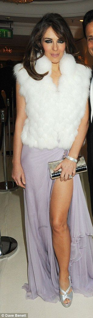 2009: For once the cleavage has been covered in fur, but that left thigh is clearly on sho...
