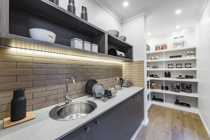 A Butler's Pantry of your dreams! This Pantry is featured at the Metropolitan 40, Googong. Learn more at http://www.mcdonaldjoneshomes.com.au/home-designs/metropolitan #bricksplashback #mcdonaldjones #mcdonaldjoneshomes