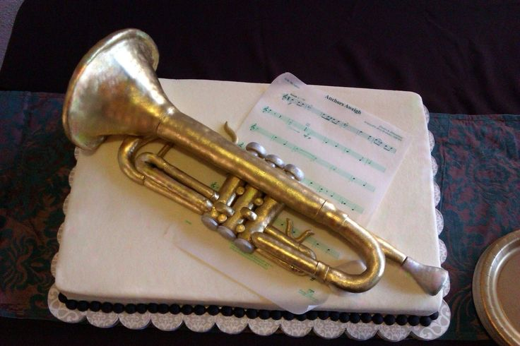 Husbands birthday cake wont look like this. Trumpet Cake - The scale trumpet was made of rice crispie treats, covered in fondant and painted with edible gold/silver dusts. Made for a military (Navy...hence the Anchors Aweigh piece) trumpet player.