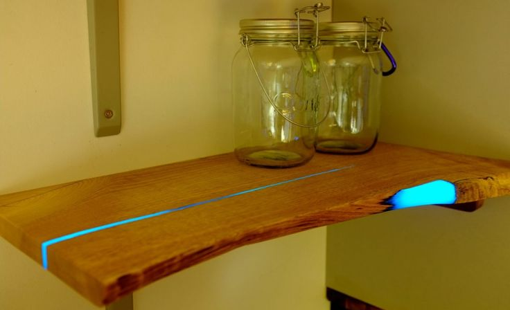 DIY Glowing Resin Filled Wood Shelves  This could easily be used for other things.