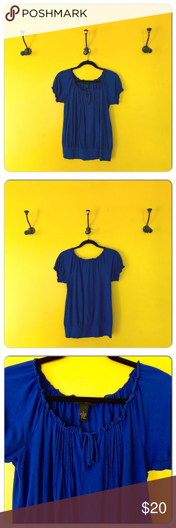 INC Cobalt Blue Short Sleeve Top INC Cobalt Blue Short Sleeve Top.  Vibrant blue with a tie neckline, pleat detail down the front, elasticized ruffled band on sleeve and a banded bottom that is not too binding.   Approximate Measurements:  B: 18  L: 24 INC International Concepts Tops Tees - Short Sleeve