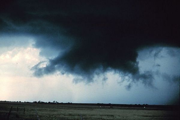 Like tentacles waiting to reach down  This wall cloud nicely shows the rear flank downdraft (RFD), an area of descending air said to be essential for tornado formation. Photo: NOAA.