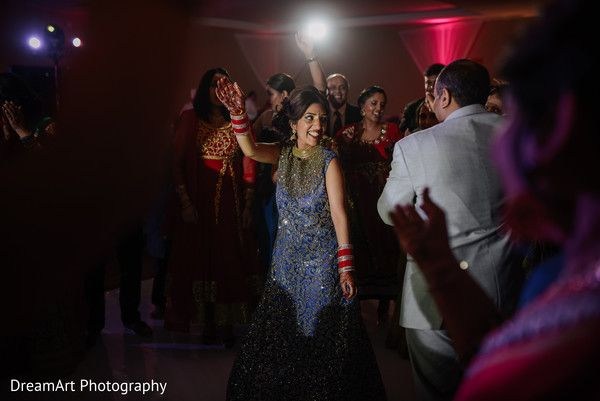 Indian couple and guests dancing at wedding reception at Moon Palace Cancun #destinationwedding