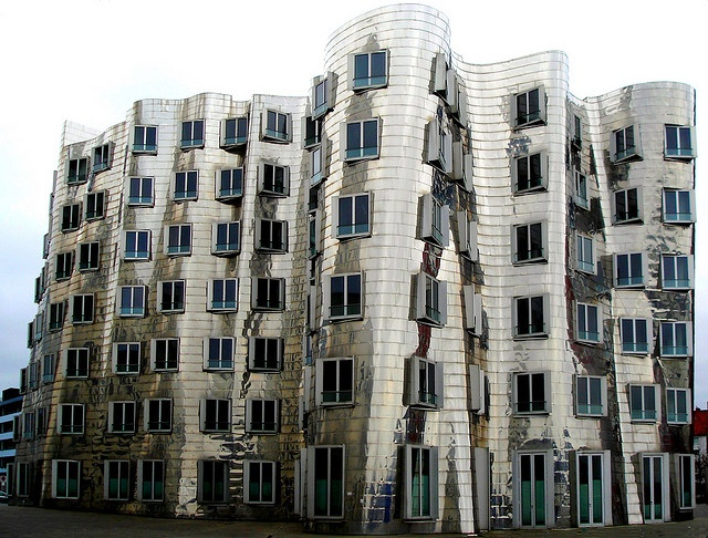 """Mirror Facade    One of the most fascinating building i've seen.    The warped forms of Frank Gehry's structures are classified sometimes as being of the deconstructivist, or """"DeCon"""" school of postmodernist architecture."""