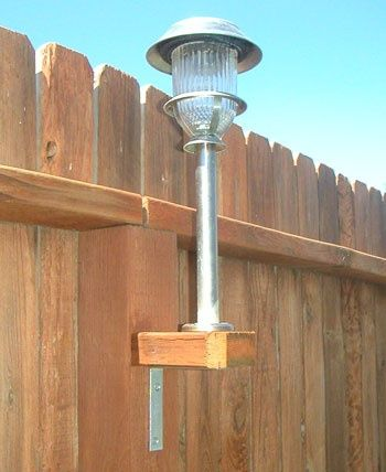 "Great idea for a large back yard: Use your solar lights. They aren't just for the ground!  Take a 2x4 and cut them into squares to fit the existing fence posts. Using galvanized screws - not nails - to screw a ""L"" bracket to the underneath base. Then on top, screw on the stake."