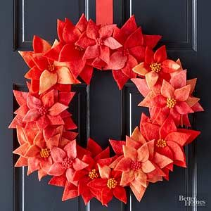 This lovely poinsettia wreath is a soft and delicate decoration you can enjoy on your front door all season.