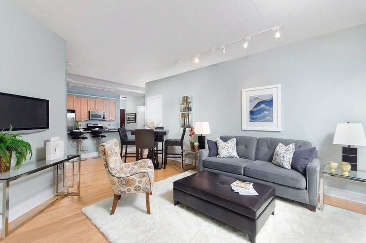 Light-blue freshens up the whole look of the living room - don't be afraid to use unconventional colors on your walls.