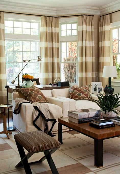 Neutral living room.  I like the striped window panels that were made to work with potentially difficult wall angles.
