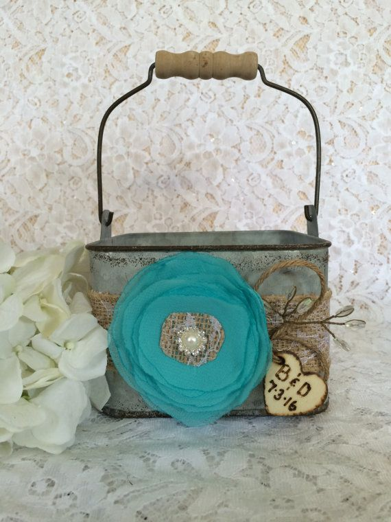 This charming flower girl bucket will be the perfect finishing touch to your rustic, outdoor, beach, country, shabby chic, vintage style or barn wedding. This flower girl galvanized bucket is decorated with burlap ribbon, handmade chiffon flower (shown in # 30/turquoise), jute, wire beaded accent, and is finished with a lace burlap center and pearl/rhinestone brooch. Bucket measures 5x5x3.5 Dont see what youre looking for ? I would love to custom make a one of a kind piece for you. All…