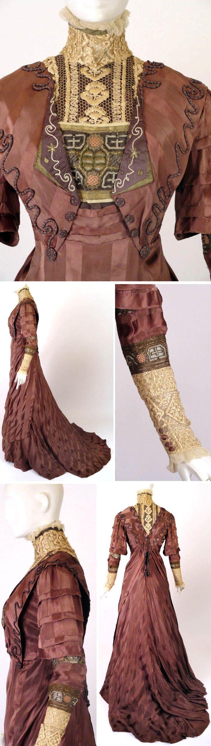 Dinner gown, J. Franken, Brooklyn, ca. 1910. Mauve silk satin stripe. Embroidered yoke in silk crewel w/brown taffeta facing. Gold ribbon & chiffon ruffle at collar. Embroidered bullion net across yoke w/small revers, embroidered & trimmed in gold bullion. Natural waistline. Draped apron front panel. Bell-shaped sleeves w/horizontal tucks; under-sleeves in silk & bullion embroidered lace, w/ivory embroidered lower sleeve edged in ivory chiffon. Vintage Martini