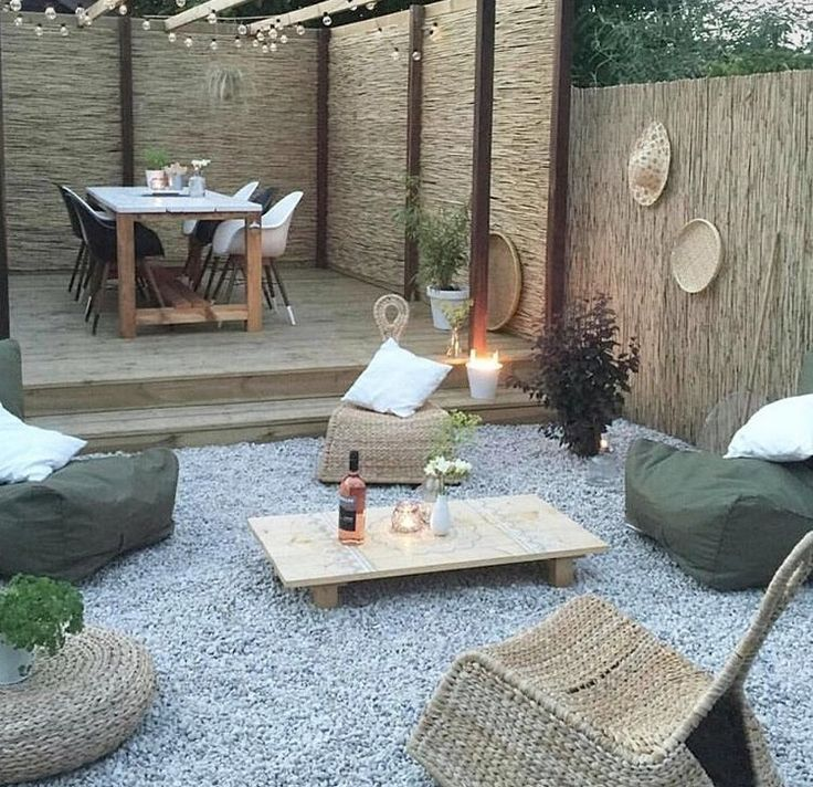 Summer style!! Modern Bohemian style with a pea gravel patio and wood deck with woven bamboo fencing for privacy around the whole garden and yard!