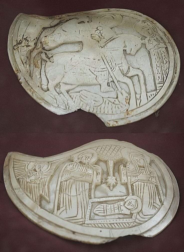 Two mother-of-pearl buckles with religious iconographical themes.  From the Kayseri area, folk art, probably 18th-19th century.  Rum (Anatolian Greek) or Armenian.  Originally set in a metal (often silver) frame.  The representations are 'St. Georges slaying the Dragon' (top) and 'the Nativity' (bottom).  On exhibit in the Kayseri Museum of Archaeology.  (© Dick Osseman).