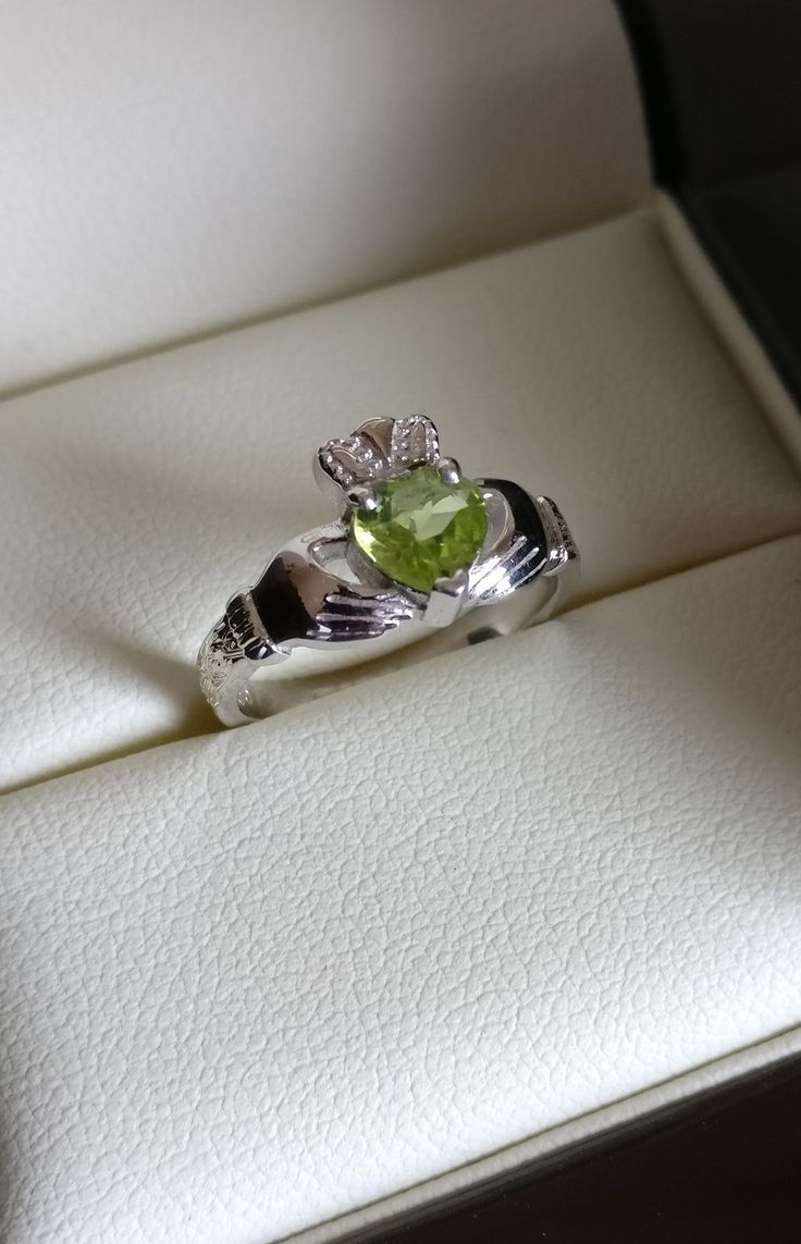 Claddagh Engagement Ring with brilliant peridot gemstone | Contact us to create your unique Irish engagement ring with free secure worldwide delivery included on all order | Claddagh Design Jewelry Designers & Silversmiths