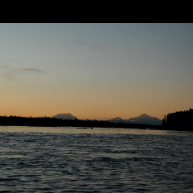 Mt. Foraker, Mt. Hunter, Mt. McKinley sunset from river