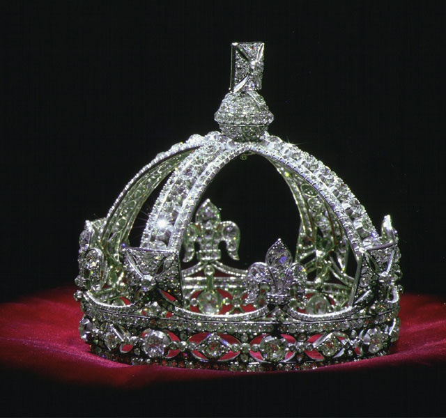 Queen Victoria's small diamond crown on display in the Jewel House at the Tower of London.