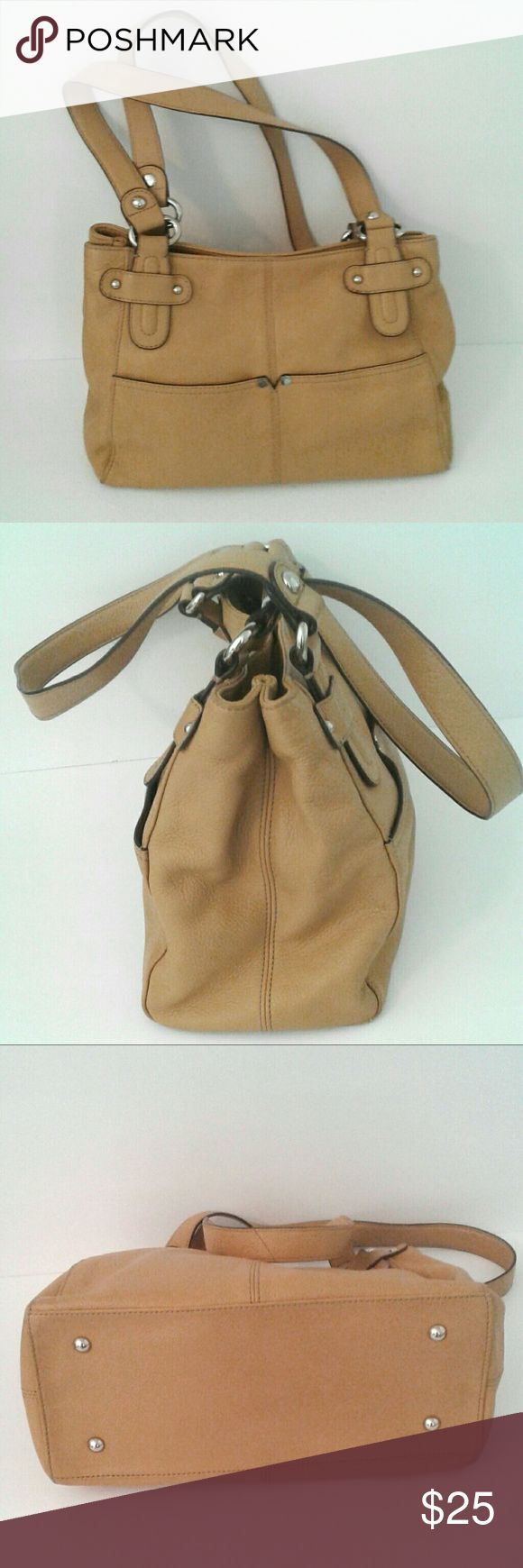 "Tignanello camel shoulder bag almost new Excellent used condition. Magnetic close open top. Two large interior compartments (one w/zip pocket) divided by center zipper section. Two outer pockets on both front and back. Hope that made sense.  Floor measures 5""x 12"",  height is 9"" and almost a 12"" strap drop.  Color is best match in image #6.  Stylish, roomy bag. No offers on this listing. Bundle & save 15%  Happy Poshing ; ) Tignanello Bags Shoulder Bags"