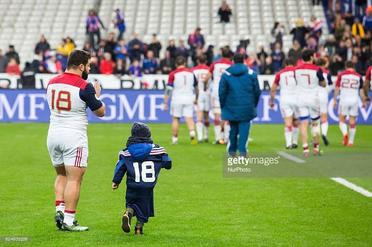 Frances player Rabah Slimani and his child after the rugby union test match between France and Australia at the Stade de France in Saint-Denis, outside Paris, on November 19, 2016.