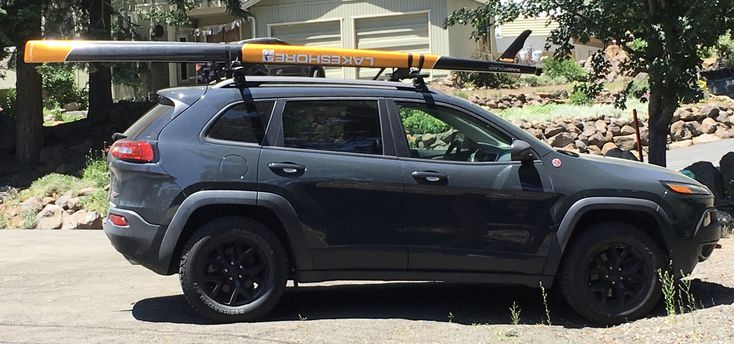 2017 Jeep Cherokee Trailhawk with paddle board roof rack.