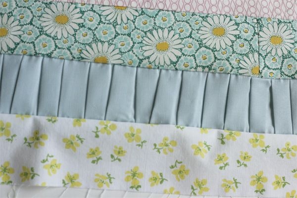 Cool strip quilt with pleats! http://seekatesew.blogspot.co.uk/2012/04/pleated-strip-quilt.html