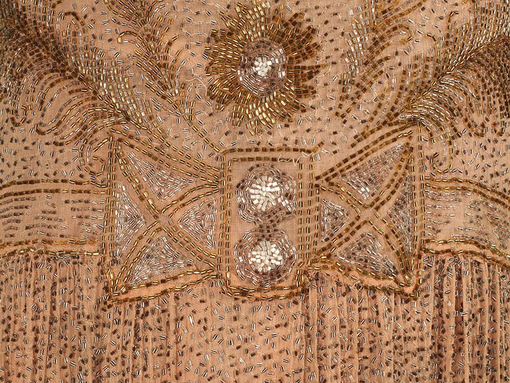 Detail from beaded dress. Lots more photos on the Shoe Icon site. Looks to me to be 1920s again...flapper era.