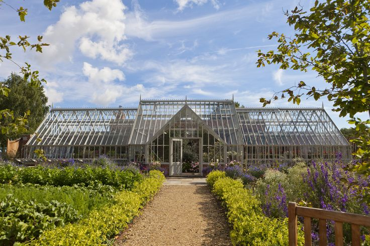 A large greenhouse with a wide central section and 2 'wings' - perfect for a busy working walled garden.