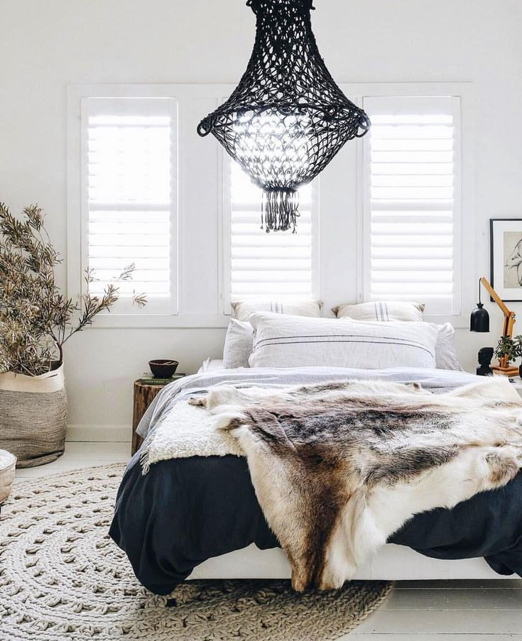 black and white and neutrals in the bedroom with animal hide