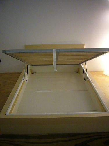 IKEA hack – use a full-sized Malm bed frame and insert a Sultan Alsarp mattress base inside (it has the built-in lifing mechanism as shown in the pic) – now you can put the mattress on top of the frame/slats and lift it up easily to store things under the bed. AMAZING! I was planning on getting a full-sized Malm bed this spring so now I'm going to do this – BONUS STORAGE. love it!! :)