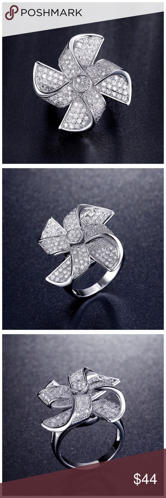 """🆕 Swarovski Crystals Pinwheel Flower Ring ‼️ PRICE FIRM ‼️ 10% DISCOUNT ON 2 OR MORE ITEMS FROM MY CLOSET ‼️   Handmade Using Swarovski Crystal Ring   Retail $128  To say that this is a spectacular ring would be an understatement. Beautifully & skillfully handcrafted using the finest Swarovski crystals with a 14K white gold overlay. This is a true statement piece. Pave set crystals. Ring is approximately .1.2"""" in diameter. Comes with a beautiful gift box. Jewelry Rings"""
